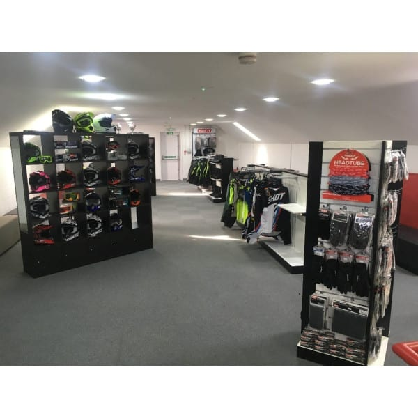 Showroom view of helmets and accessores